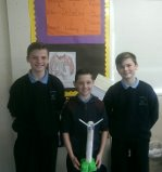 Seamus, Christopher and Dean with their wind turbine.