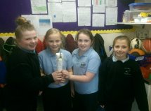 Cora-Lee, Megan, Maeve and Ciara proudly show off their wind turbine!