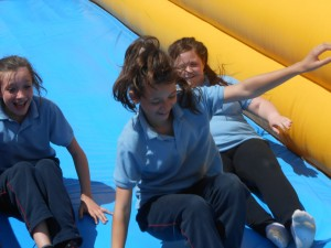 6th Class enjoying their time on the bouncy castles..