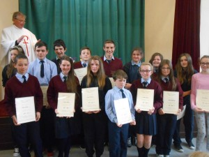 6th class receiving their certificates at this years graduation mass.