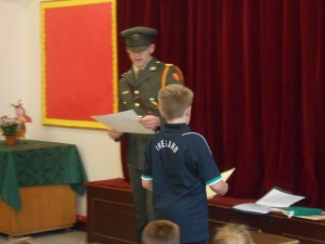 Cian prepares to read the proclamation with Lieutenant Hurley.