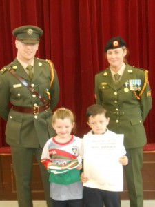 Emily and Cayden accept the Irish Flag on behalf of Kilberry N.S.