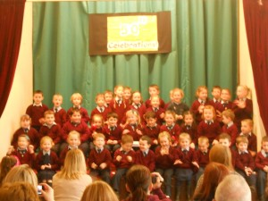 Junior and Senior Infants under the direction of Ms. Cawley and Ms. Carter performing, 'HELP!'