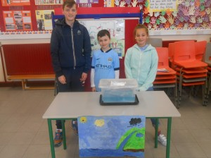 Seamus, Leah and Conor demonstrate the water cycle..