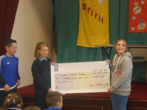 Christopher, Molly and Sarah display the cheque to be presented to Crumlin!