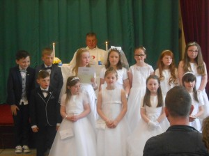 Second class pose happily in their communion finery!!